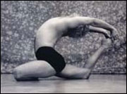 John Friend performing Valakhilasana
